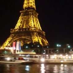 Night tour in Paris. The Eiffel tower from the boat.