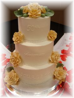 """- 10""""x8""""x6"""" iced with butter cream icing, I've used Sugarshack's icing,  which is big THANKS to her this is the best and easy icing I have ever used. I love how easy it is to smooth this icing, LOVE IT!!!!!! My gardenias (roses) was done in fondant and dusted with luster dust. Thank you all for looking at my cake!!!"""