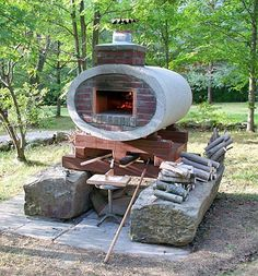 Pizza oven built in elliptical concrete drainage pipe. Brick Oven Outdoor, Brick Bbq, Pizza Oven Outdoor, Outdoor Cooking, Outdoor Kitchens, Fire Pit Oven, Fire Pit Pizza, Fire Pits, Stone Pizza Oven