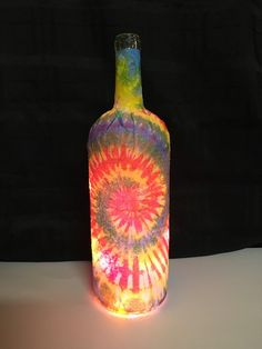 Repurposed wine bottle decoupaged with paper and filled with multicolored string lights. Great accent to any room or used as a nightlight! Wine Bottle Gift, Wine Bottle Crafts, Bottle Art, Bottle Lamps, Wine Bottles, Dorm Decorations, Birthday Decorations, Flower Decorations, Hippie Party