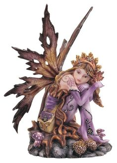 This Autumn Fairy Figurine perfectly captures the appearance of fall. This beautiful fairy sits on a rock with her knees drawn to her chest and wings reminiscent of autumn leaves. Any collector or enthusiast would certainly love to have such a pretty little fairy figurine that so perfectly embodies the autumn season.
