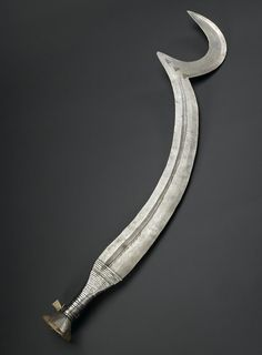 Beheading sword of iron with crescentic point and handle of wood bound with iron…