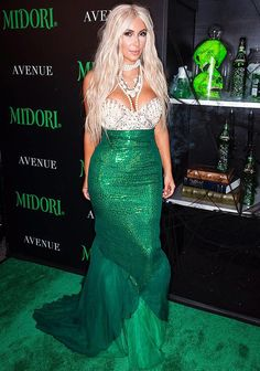 This year I decided to be a mermaid for Halloween.  Many of the mermaid costumes at the store show off the mid-drift area.  I was really inspired by Kim Kardashian's high- waisted mermaid ski…