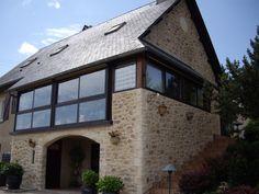 Une maison de style campagne avec l'enduit imitation pierre Decopierre®