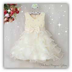 High quality ivory dress with a tiered ruffle skirt and sparkling diamanté bodice and bow  Zip up back and ribbon to tie up  Perfect for those special occasions  #dress #weddings #christening #occasion