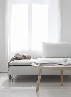 Nude tunes, Scandinavian interior design, birch furniture white modern sofa white light curtains.