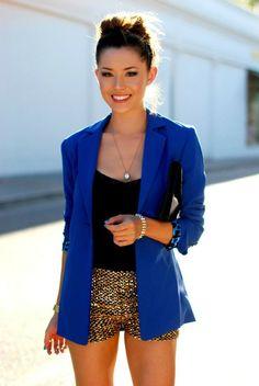 Cute outfit! blue blazer, gold short pants, black tank, necklace, bun