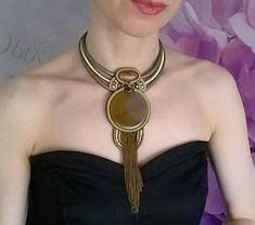 A statement necklace made in soutache embroidery technique in olive and gold with natural gemstone agate. This stunning piece of jewelry is made of soutache braid, crystals, glass beads and large olive color agate. It fits comfortably around your neck, the lenght is adjustable. Amazing with