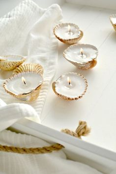 DIY Shell Candles from Burkatron. These DIY Shell Candles are made from melted wax pellets and wicks. You can also make these candles from tea lights - just take the wick out of the tealight and attach it to the shell, then melt the wax from the tea. Seashell Candles, Seashell Crafts, Diy Candles, Handmade Candles, Seashell Decorations, Handmade Decorations, Handmade Home Decor, Diy Candle Ideas, Lavender Candles