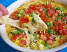 Hot Corn Dip So good!! Make ahead and refrigerate. Spoon as much as you want in baking dish. Bake. Cool. Then top with fresh tomatoes, green onions and Cilantro!!! YUM!!!