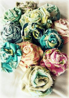 Shabby Fabric Roses Tutorial. These are my favorite of all of the fabric flowers out there.