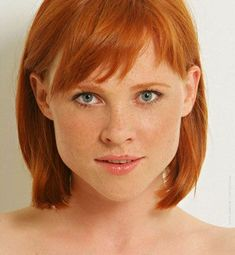 freckles and red hair this color in school... I hated it,everyone called me carrot top!!