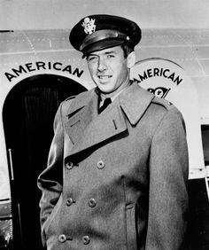 "Lt. James Stewart, former film star and now in the U.S. Army Air Corps, steps from the transcontinental ""Mercury"" of American Airlines at LaGuardia Field, New York, after a flight from the west coast, February 20, 1942. ( AP photo)"