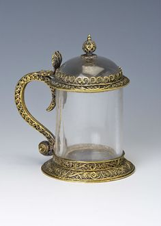 Burghley House Collection. A silver-gilt filigree mounted rock crystal tankard, perhaps Dutch, mid / late 17th Century. 9.8cms tall.