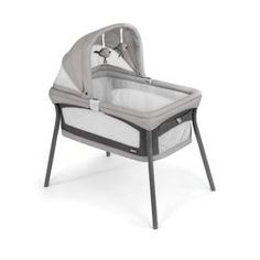 The LullaGo Nest Bassinet by Chicco is perfect for families on-the-go. With breathable mesh side panels, an adjustable canopy with hanging toys and a padded mattress with a washable cover, it folds quickly into a portable carry bag for easy transport. Bedside Sleeper, Portable Crib, Baby Bassinet, Wood Bassinet, Bedside Bassinet, Delta Children, Baby List, Kids Sleep, Baby Sleep