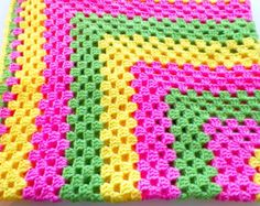 This Beautiful spring color blanket is very sweet and cute for any one trim in yellow. Color - spring Green, yellow, pink Size 40 x 40 Crochet Quilt Pattern, Crochet Ripple Blanket, Granny Square Crochet Pattern, Crochet Squares, Crochet Yarn, Granny Squares, Rainbow Crochet, Manta Crochet, Unique Crochet