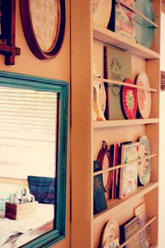 A great idea to use a plate rack to store more than just plates.  Pictures, books, and special cards.