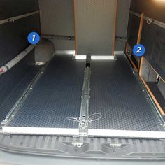 Inteior view of upgraded tracks and water tank in a custom Sportsmobile van conversion.
