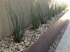 raised steel flower beds along wall