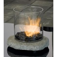 Enjoy the beauty of real fire without the necessity of having a chimney. The Stone Ventless Fireplace from Chantico brings the element of fire into modern interior spaces. The stable stone base prevents this portable piece from falling over what is an important safety factor when choosing an ethanol run biofireplace. The design matches rustic style interiors, but can be also used outdoors in your garden.