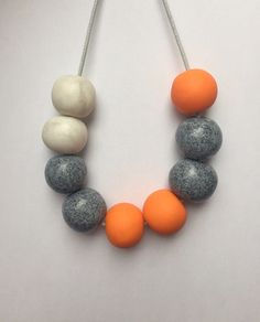 Orange and grey clay bead necklace