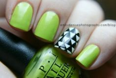 Lime green nails with a black + white accent nail. Love this for summer!