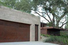 Cor-ten garage door and entry doors. the new plan.