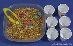 Button and Popcorn Seed Sensory Tub ... the children really loved this activity.