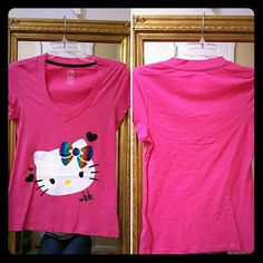 Hello kitty top Hot pink Hello kitty top by Sanrio, size medium but could also be worn by someone who is size small. *New never used but tag was taken off* *Price firm, bundle & save* Hello Kitty Tops Tees - Short Sleeve