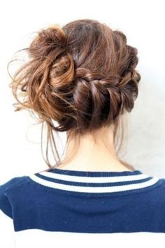 Side braid into a mid-height messy bun. Love this. Maybe add some sparkle with a clip?