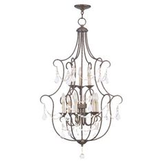Cast a warm glow in your dining room or master suite with this candelabra-inspired chandelier, showcasing draped beading and a golden bronze finish....