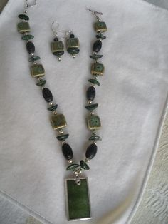 SOLD  Both precious and non precious stones are used in this necklace.  The pendant is jade.