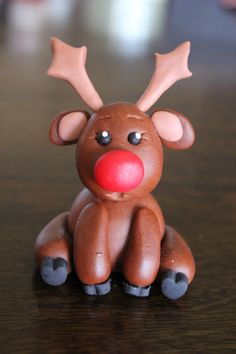 Christmas cake topper Rudolph Reindeer. Made with homemade marshmallow fondant
