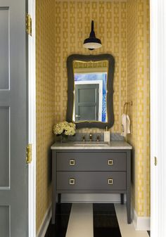 What a lovely powder room! The yellow and brown tones complement each other wonderfully! From Tobi Fairley