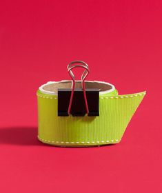 Keep rolls of ribbons organized with a binder clip.