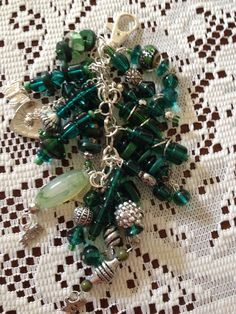 Green beads, silver chain, silver charms key chain  on Etsy, $12.00