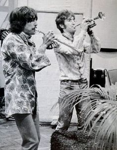 George Harrison and John Lennon (playing trumpets)