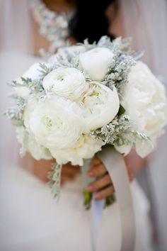 Romantic and soft with peonies, ranunculus  and dusty miller.