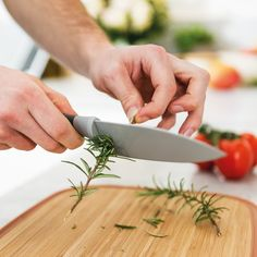 This knife set and anti-slip cutting board from BergHOFF is a must-have for every kitchen. The pastel colors are sure to add just the right amount of color to any kitchen décor. Bamboo Cutting Board, Plastic Cutting Board, Stainless Steel Knife Set, Knife Making Tools, Trench Knife, Best Pocket Knife, Pocket Knives, Heat Treating, Knife Sharpening