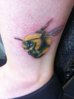 Colour-realistic bumblebee tattoo - add to lilies tattoo