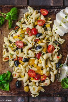 Pasta Salad With Basil Vinaigrette. Garlic, yellow and red cherry tomatoes, olives, chives, red and yellow peppers, basil, olive oil. Vegetarian