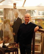 Portrait painter Anthony Morris '58 with his new painting of John Henry Brookes.