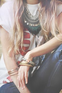 Stacked bracelets and statement necklace to dress up a messy t-shirt/jeans look. Love it.