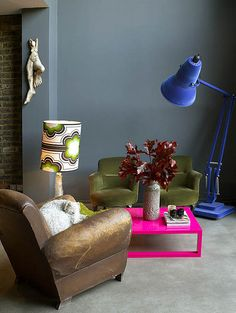 Bright pops of colour against atmospheric darker tones - Abigail Ahern