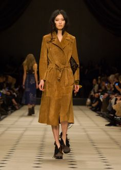 beautiful- Geometric panels and whipstiching on a structured suede trench coat with The Ponytail boot.