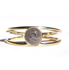 Sophisticated 14K yellow gold twin band cremation ring encompassing solidified ashes within a 8mm circle setting.