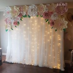 Tropical themed backdrop for an engagement party. Pink, cream, and white paper flowers with warm fairy lights Tropical themed backdrop for an engagement party. Pink, cream, and white paper flowers with warm fairy lights. Bridal Shower Backdrop, Baby Shower Centerpieces, Bridal Shower Decorations, Tulle Backdrop, Diy Party Backdrop, Backdrop With Lights, Decorations For Quinceanera, Wedding Centerpieces, Paper Flower Backdrop Wedding