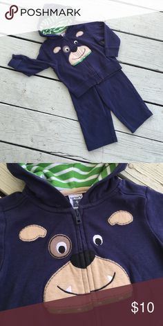 Carter's 9 months Doggie Navy Set Carter's 9 months Doggie Navy Set. Jacket with zip front and adorable doggie face design. Hood lined with green striped fabric. Super cute! Carter's Matching Sets