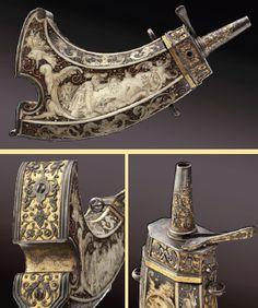 A gilt magnificent powder flask with iron chiselling, Caspar Spät, Munich, circa 1640.