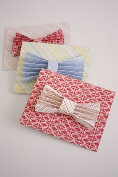 DIY Father's Day Bow Tie Cards!  Accordion-fold patterned cardstock and cinch in the middle to form your bow.  For straight lines and easy folding, use a scoring board.  Scor-Pal is our favorite, check it out at www.cardstockshop.com. under Tools!